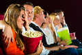 Group young people watching creepy movie movie theater Royalty Free Stock Photos