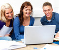 Group of young students studying on laptop Royalty Free Stock Images