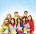 A group of young teenagers on a snowy background and happy caucasian in modern clothes hanging out together the image is taken Stock Images