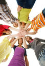 A group of young teenages holding hands together and happy caucasian teenagers in modern clothes the image is taken isolated on Stock Photos