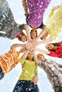 A group of young teenages holding hands together and happy caucasian teenagers in modern clothes the image is taken on light and Royalty Free Stock Photos