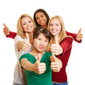 Group of young women holding thumbs up happy their Royalty Free Stock Images