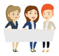 Group of young women holding white blank board. Royalty Free Stock Photo