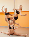 Group of young women posing in pole dance Stock Photography