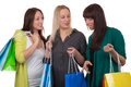 Group of young women with shopping bags talking about their purchase isolated on a white background Stock Photos