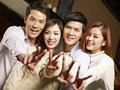 Group of youngster having fun in bar young asian couples a good time Stock Images