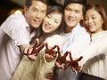 Group of youngster having fun in bar young asian couples a good time focus on hands Stock Photography