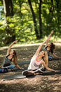 Group of youngsters practice yoga in tranquility of nature pretty Stock Photo