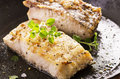 Grouper fillet fried with herbs as closeup in a fryer Royalty Free Stock Photography
