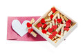 Groups of heart shaped clothes pin in a box on white Royalty Free Stock Photo