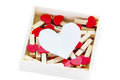 Groups of heart shaped clothes pin in a box on white Stock Photos
