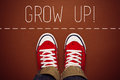Grow up reminder for young person top view in red sneakers about to make a step and join the party Royalty Free Stock Photography