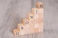 Growth blocks arranged as progressive graph on wooden table Stock Photo