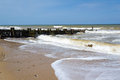 Groynes at mundesley norfolk england timber on the coast uk europe Stock Photos