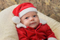 Grumpy Baby in a Santa Suit Royalty Free Stock Photo