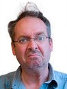 Grumpy Man with Unkempt Hair Stock Photography