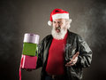 Grumpy santa claus with gift boxes and cigarette Royalty Free Stock Images