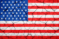 Grunge American USA flag, broken crack wall with rift Royalty Free Stock Photo