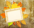 Grunge background with autumn leaves and wooden frame Royalty Free Stock Photography