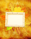 Grunge background with autumn leaves and wooden frame Royalty Free Stock Images