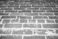Grunge background. Bottom view of  gray brick wall. Royalty Free Stock Photo