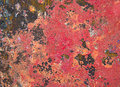 Grunge background in red and rusty colorful Royalty Free Stock Photo