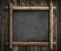Grunge Blackboard Hanging On W...