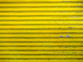 Grunge bright yellow roller shutter door texture background Royalty Free Stock Photo