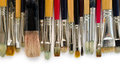 Grunge brushes stuff for artist over white Royalty Free Stock Photo
