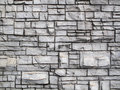 Grunge crafted old rock wall a simulated textured cement styled stone Stock Images