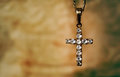 Grunge crystal cross with gemstones over brown background Royalty Free Stock Photos