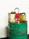 Grunge dirty oil drum, spout and buckets. Royalty Free Stock Photo