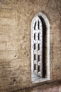 Grunge gothic doorway wooden studded old stone walls with effects Stock Image