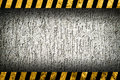 Grunge grey wall background with warning stripes Royalty Free Stock Photo