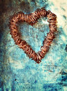 Grunge heart on blue wall Stock Image