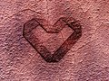 Grunge heart embossed on rusty metal surface valentine concept Royalty Free Stock Photos