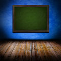 Grunge interior with blackboard Royalty Free Stock Images