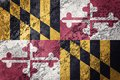 Grunge Maryland state flag. Maryland flag background grunge text Royalty Free Stock Photo