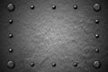 Grunge metal background. rivet on metal plate.