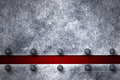 Grunge metal background. rivet on metal plate and red carbon fib