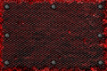 Grunge metal background. rivet on red metal plate and black gril