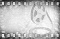Grunge old motion picture film reel with strips Royalty Free Stock Photo