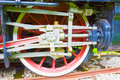Grunge old steam locomotive wheel and rods Royalty Free Stock Photo