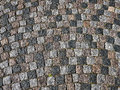 Grunge old stone cobbles as a background Royalty Free Stock Photo