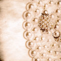 Grunge pearl necklace background Stock Photography