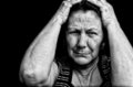 Grunge portrait of an old stressed woman Royalty Free Stock Photos