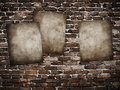 Grunge posters on brick wall Stock Photo