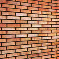 Grunge red yellow beige tan fine brick wall texture background perspective textured pattern