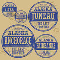 Grunge rubber stamp set with names of alaska cities Royalty Free Stock Photos
