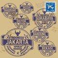 Grunge rubber stamp set with names of indonesia cities Royalty Free Stock Images